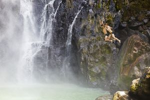 Dominica, Delices. Two people jump into the plunge pool at the foot of Victoria Fals.