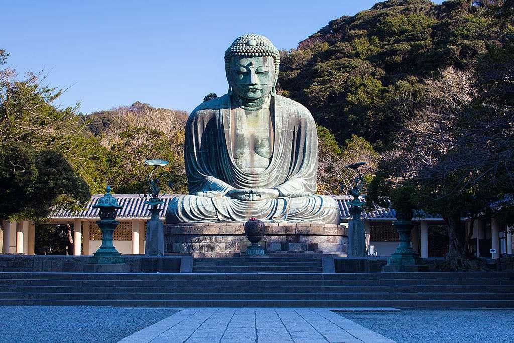 aged buddha statue in Kamakura