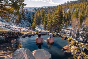 Tourists relaxing in hot spring near Bridgeport, California, USA