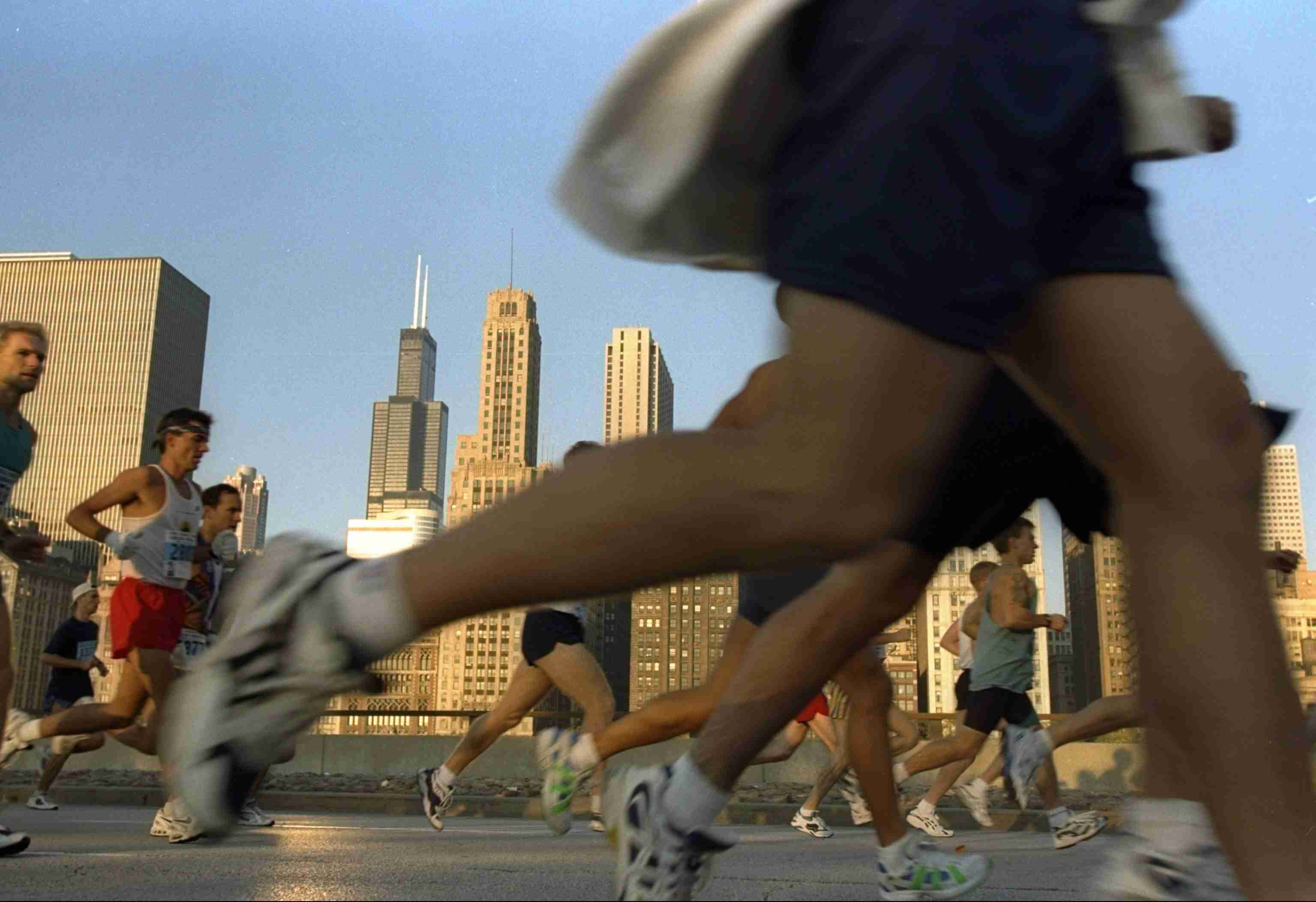 Road-level view of runners in the Chicago Marathon