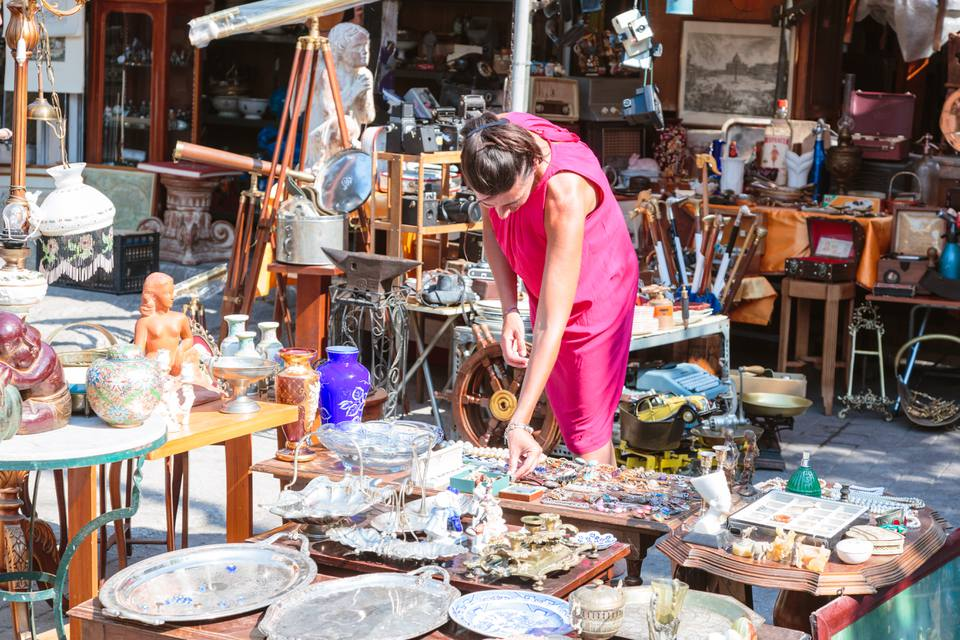 Woman in a flea market shopping for bargains