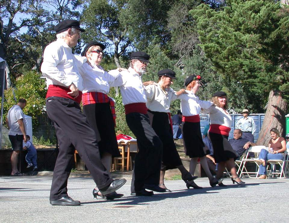 People performing a Greek line dance at the Greek festival in Belmont, California.