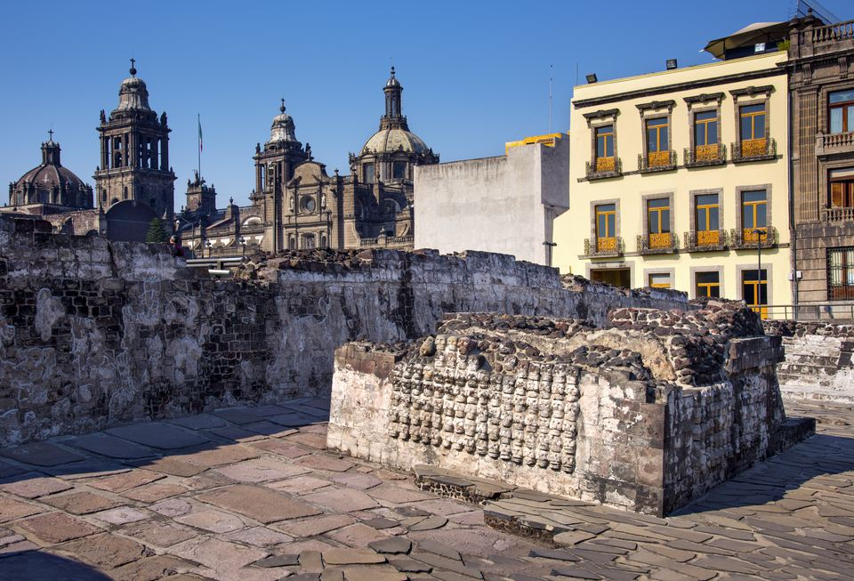 Mexico, Mexico City, Tenochtitlan, Walls Of Skulls and Great Temple in Aztec Ruins with Metropolitan Cathedral In Background