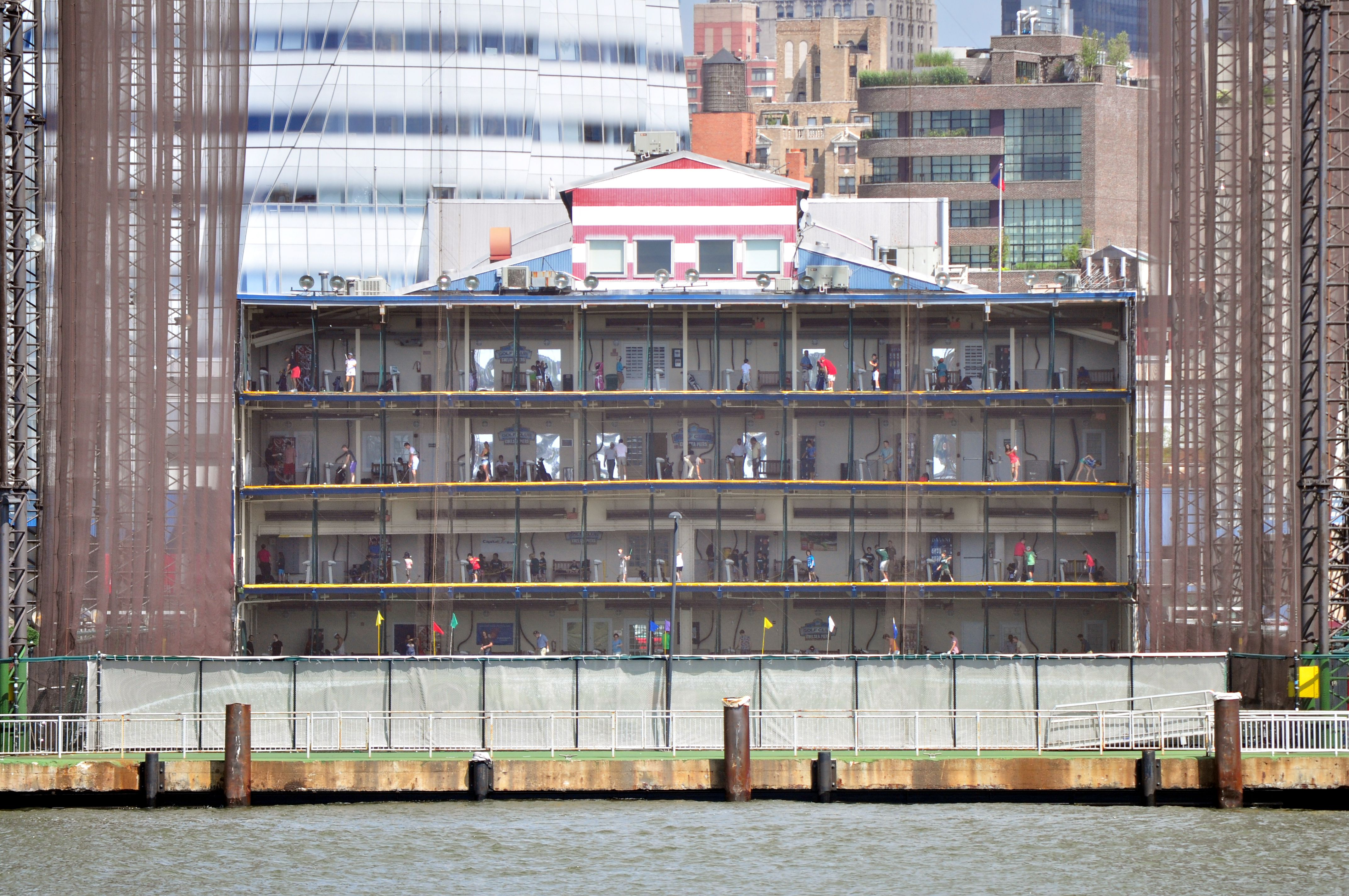 Driving range, Pier 59 (one of the Chelsea Piers) seen from New York Water Taxi on the Hudson River.