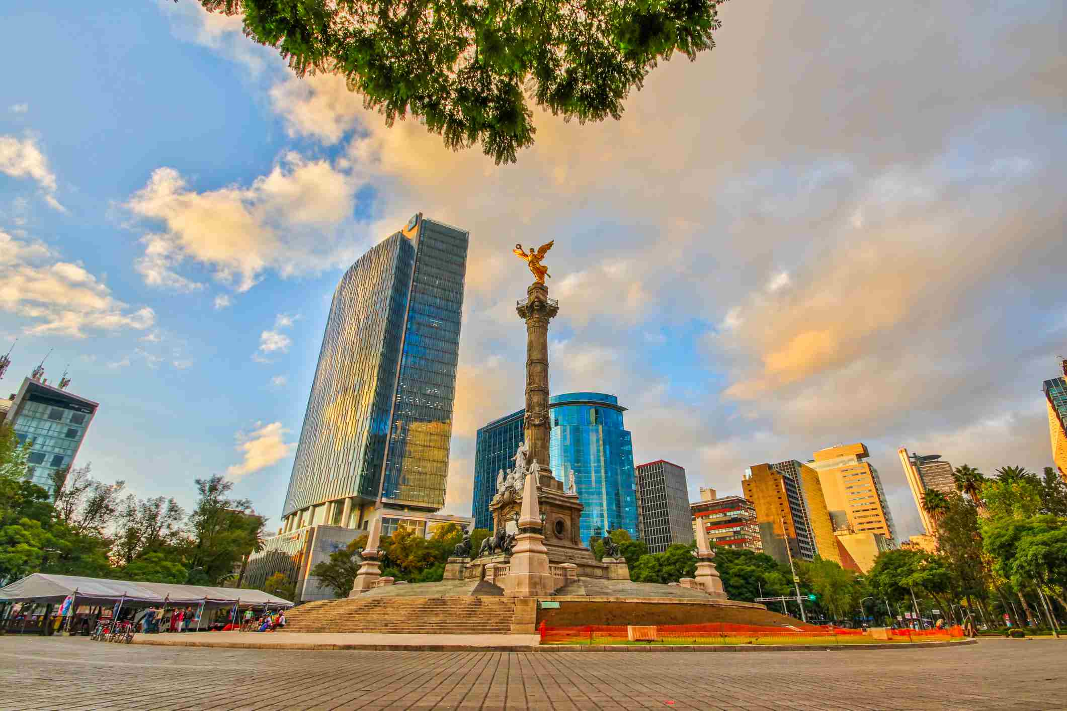 A multitude of photographs from every angle imaginable of the Angel of Independence monument in Mexico City's Reforma Avenue