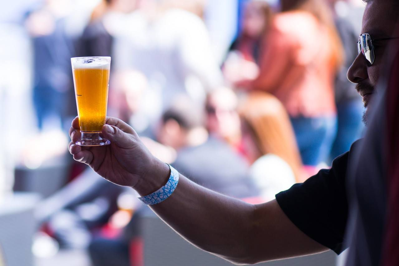 Someone holding a sample of beer at DC Beer Festival