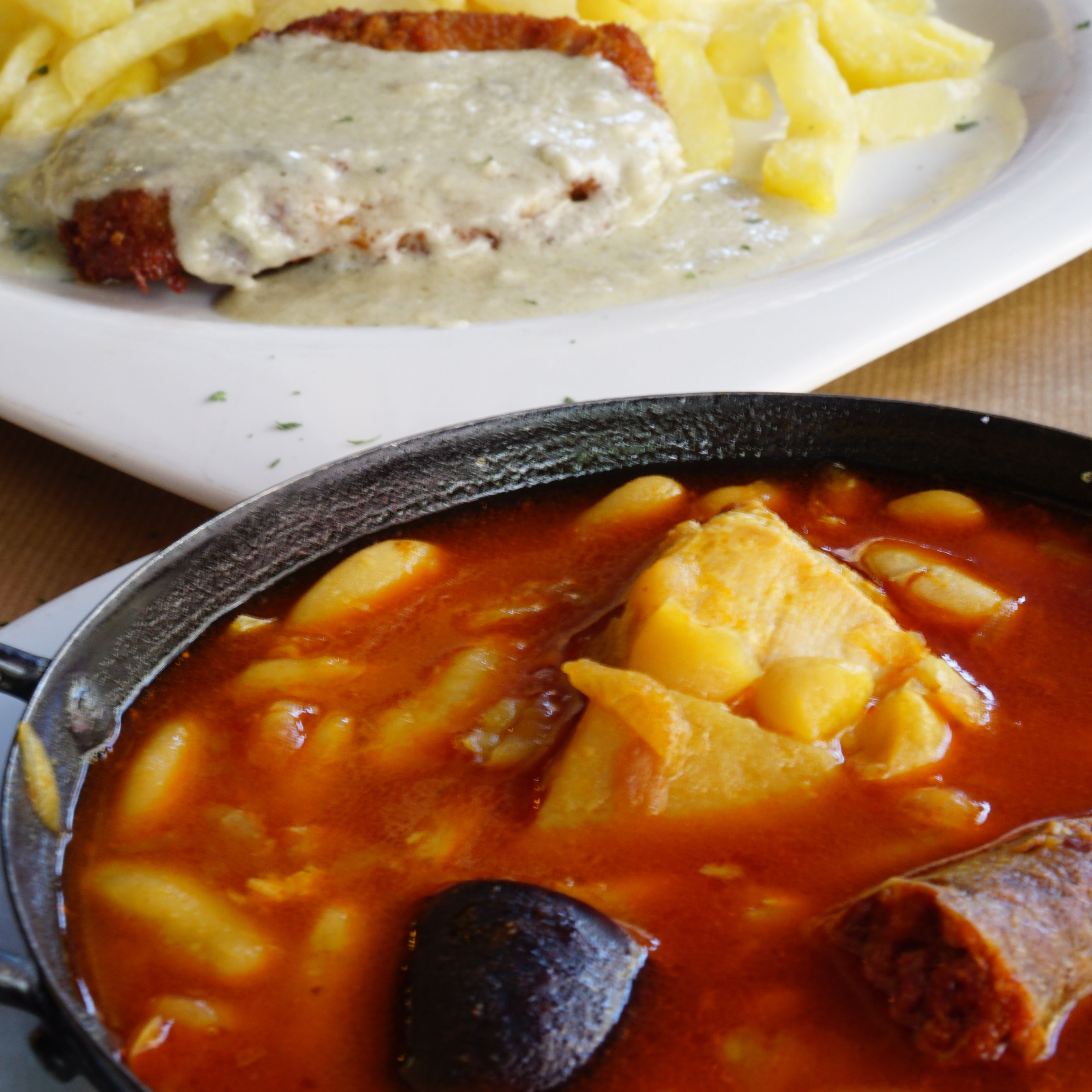Cachopo in cabrales sauce and fabada, two traditional Asturian dishes