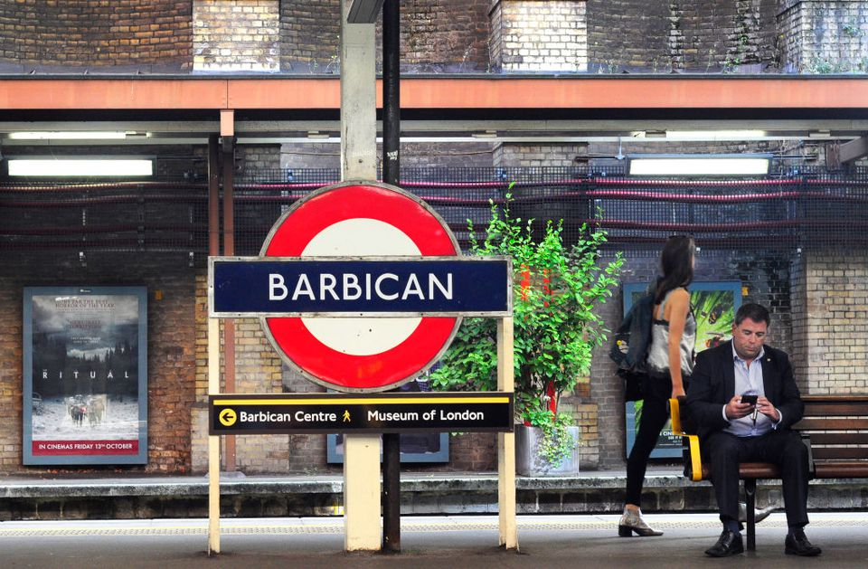 Man waits for train at Barbican station in London