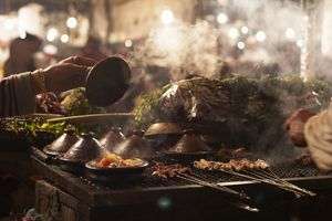 Meat skewers and tagines cooking on the grill in Morocco