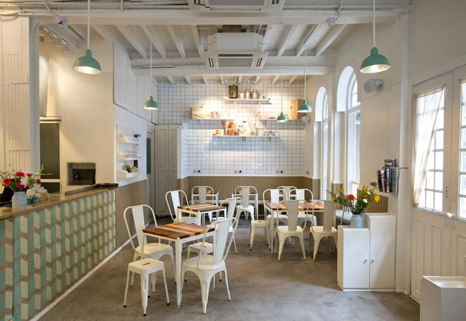 Interior of a mostly-white cafe