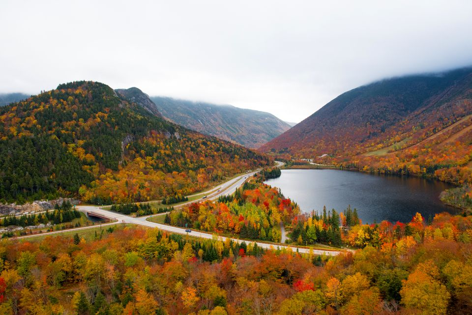 Franconia Notch in autumn. View from Artist's Bluff looking across Echo Lake down the Notch. Cannon Mountain and Mount Lafayette on the right and left.