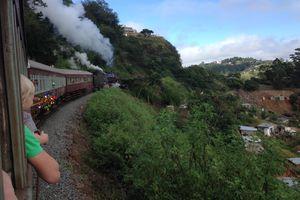A train winding its way through a hillside