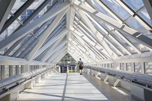 Man walking through glass and steel Skyway at Minneapolis-Saint Paul International Airport, Minnesota