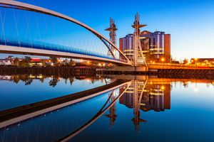Stock Photo of the Millenium Bridge at Salford Quays in Manchester, England at twilight blue hour.