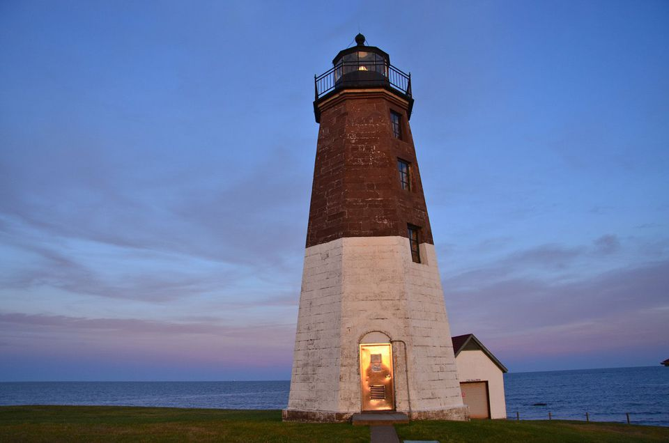 Like many of New England's lighthouses, the distinctive brown and white Point Judith Light remains an active aid to navigation.
