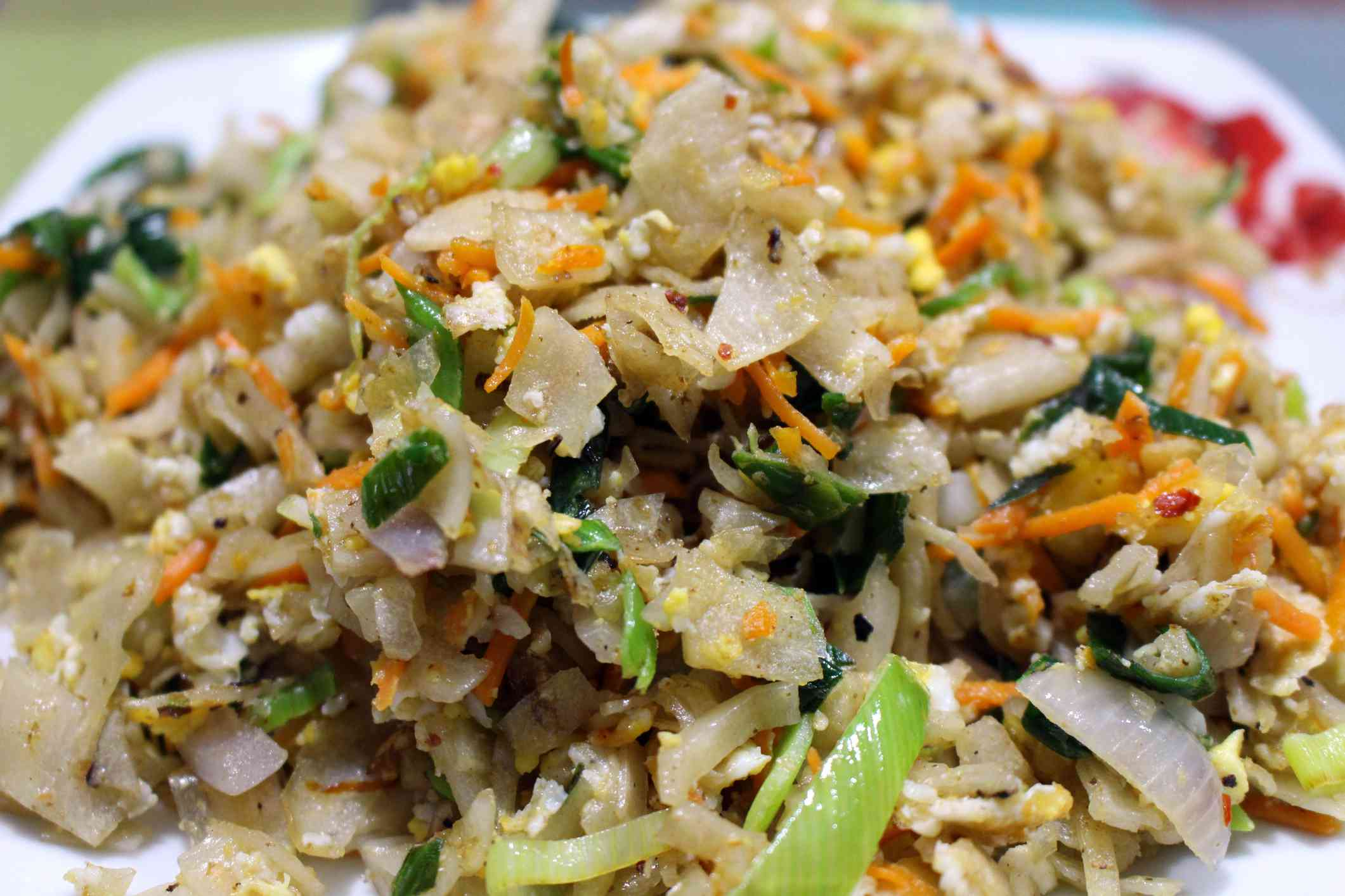 Kottu roti with onions, carrots, and scallions