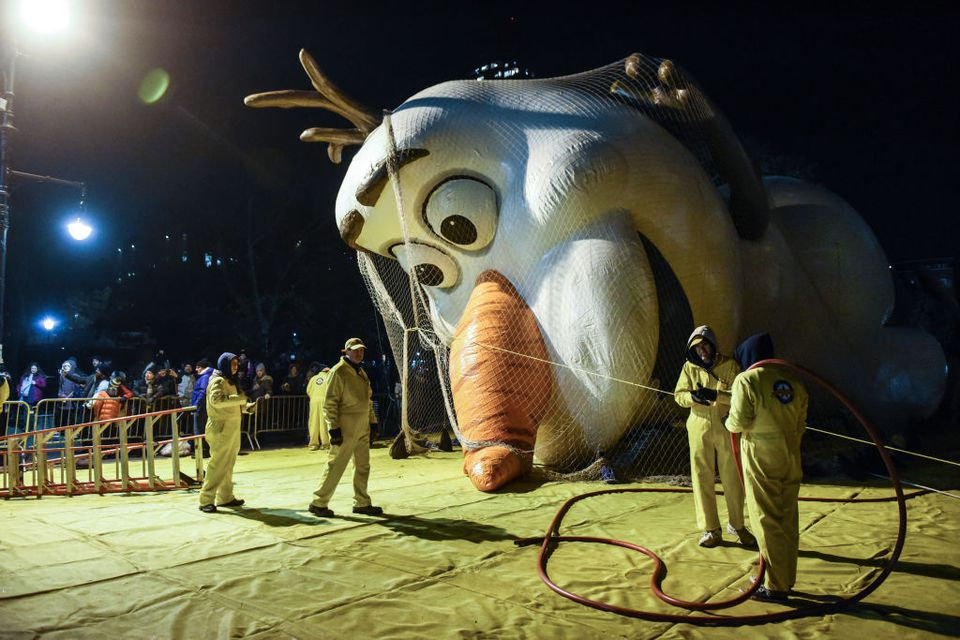 Workers inflate an Olaf balloon ahead of the Macy's Thanksgiving Day Parade