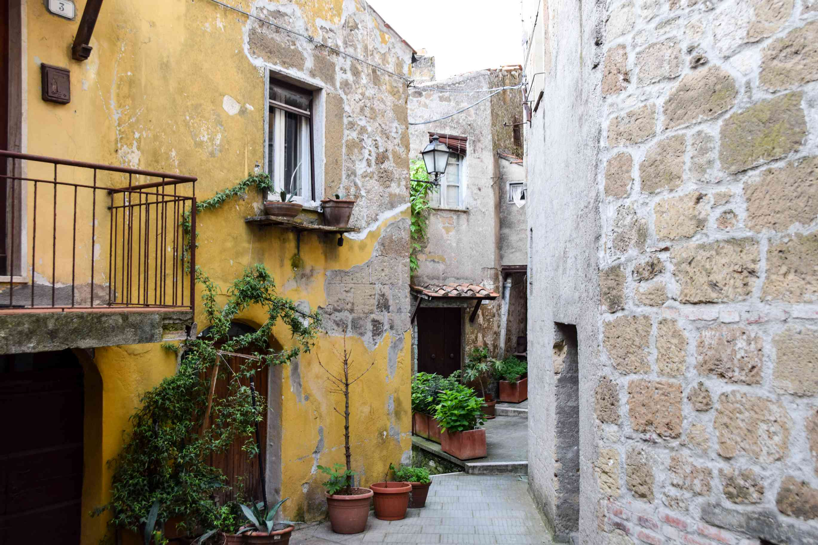A small alleyway with ancient walls in Pitigliano