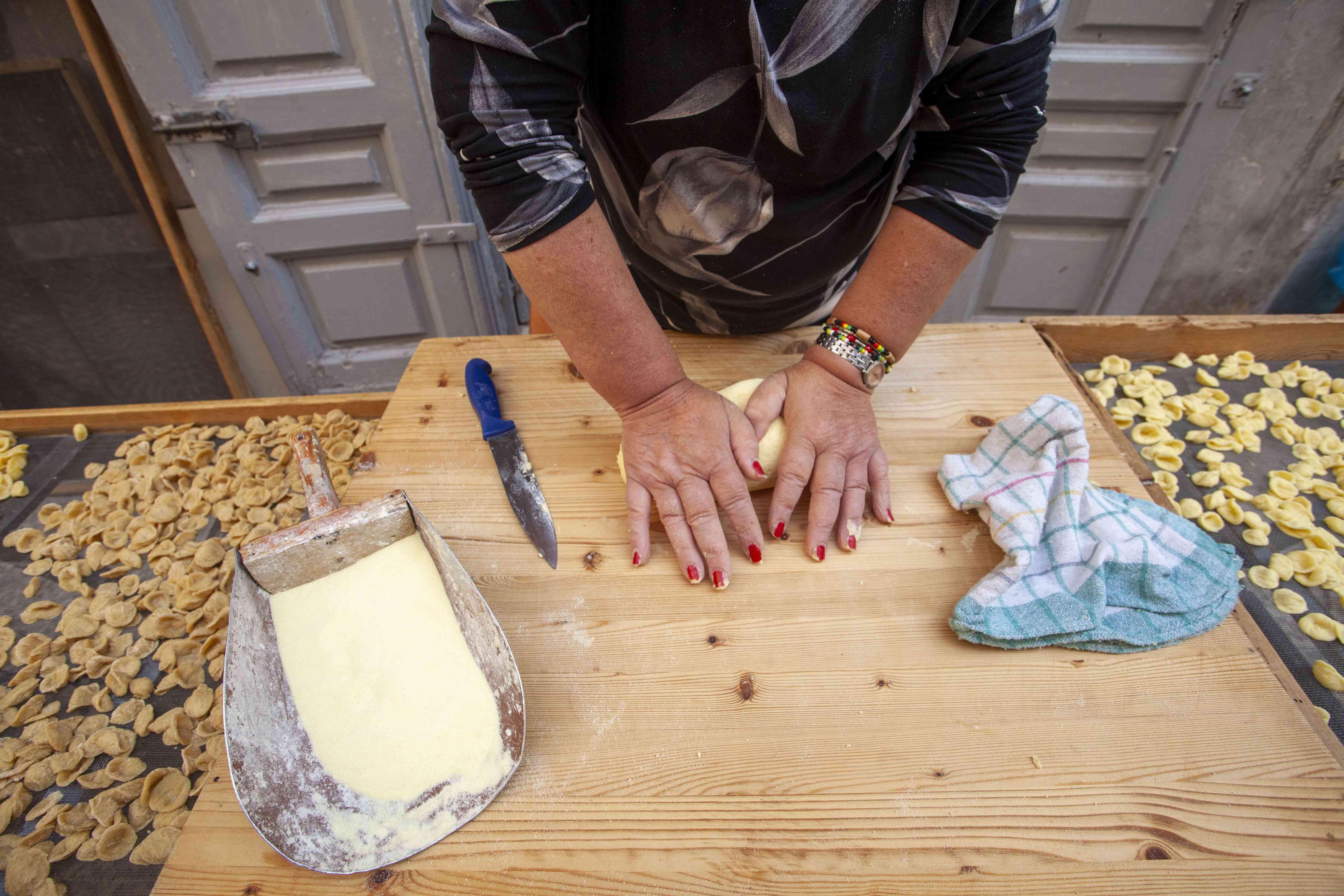 Italian woman in Bari making orecchiette