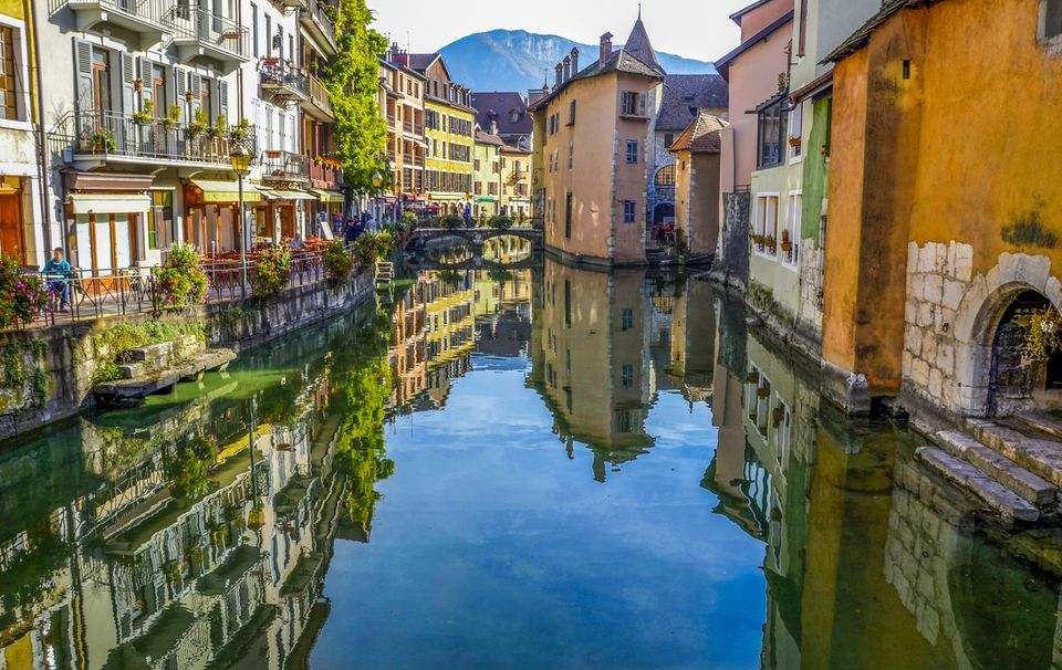 colorful buildings along a reflective canal