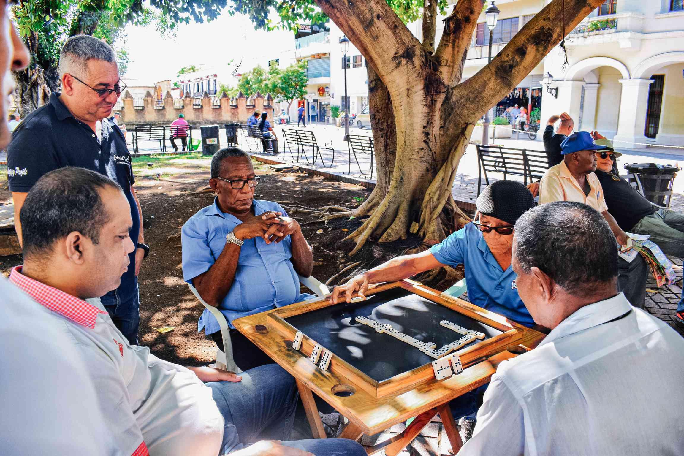 Men playing dominos in Parque Colon