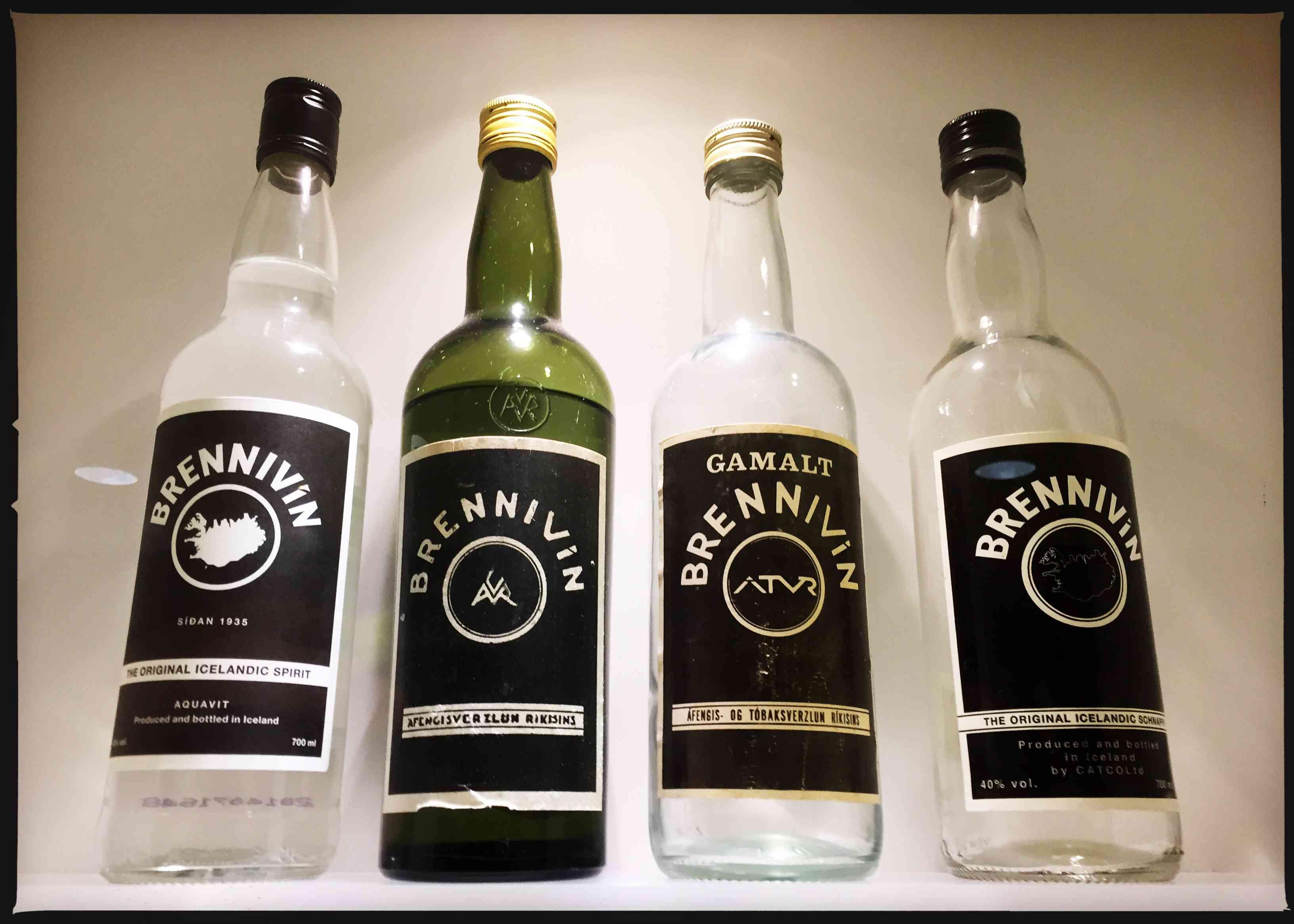 Four vintage bottles of Brennivin