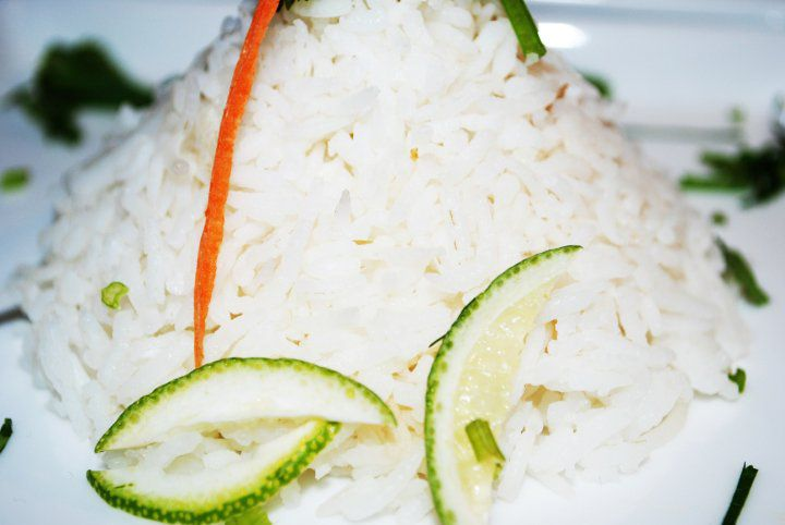 close up of white rice with small slices of lime