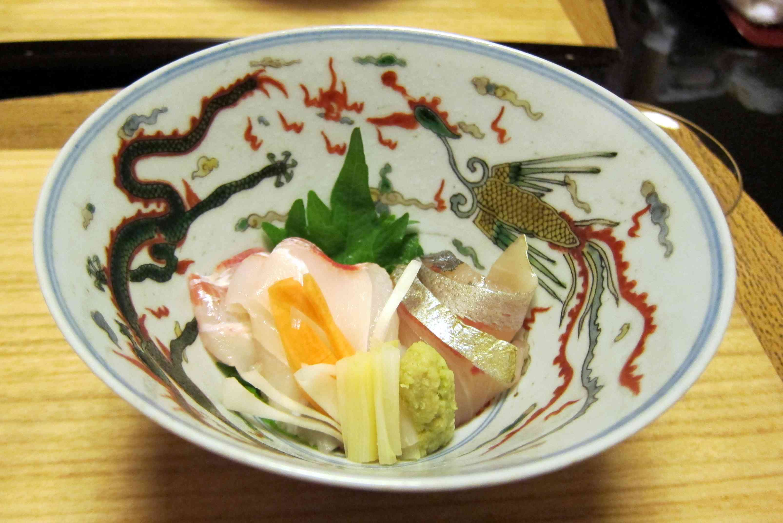 Sashimi and wasabi in a painted bowl. It's one of many kaiseki courses