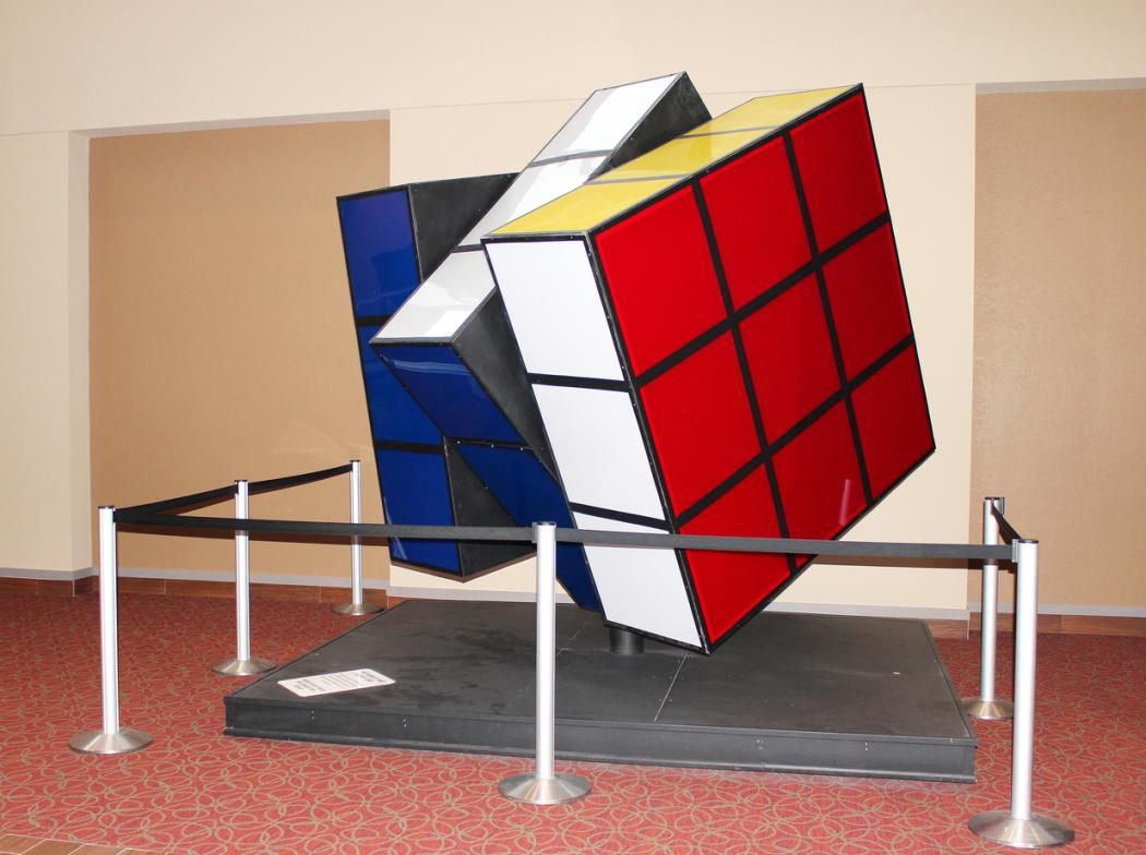 Large motorized Rubik's cube on a display stand