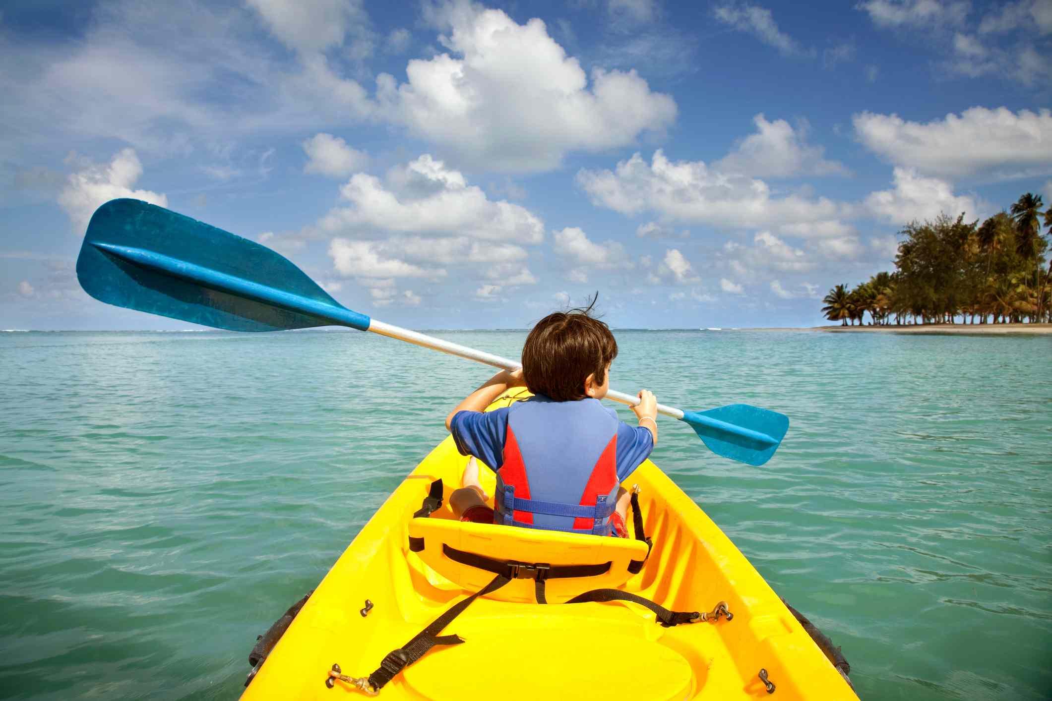 Child kayaking in Puerto Rico