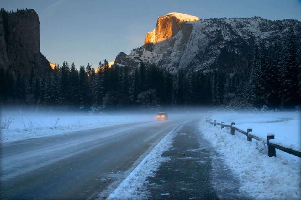 Setting sun on Half Dome in winter at Yosemite National Park