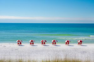 Colorful Row of Red Chairs on the Beach