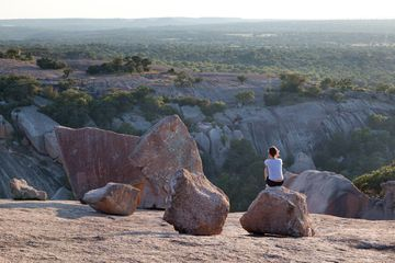 Woman sitting on top of Enchanted Rock