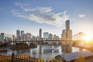 Sunrise behind Story Bridge and Brisbane city skyline