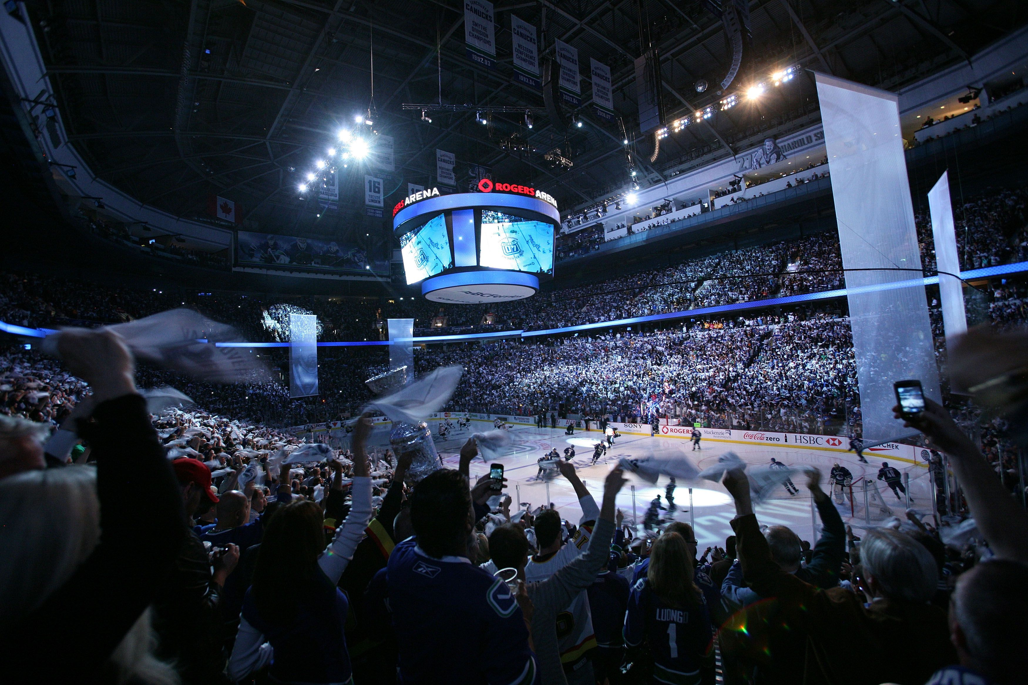 Fans cheering on the Canucks inside Rogers Arena in Vancouver
