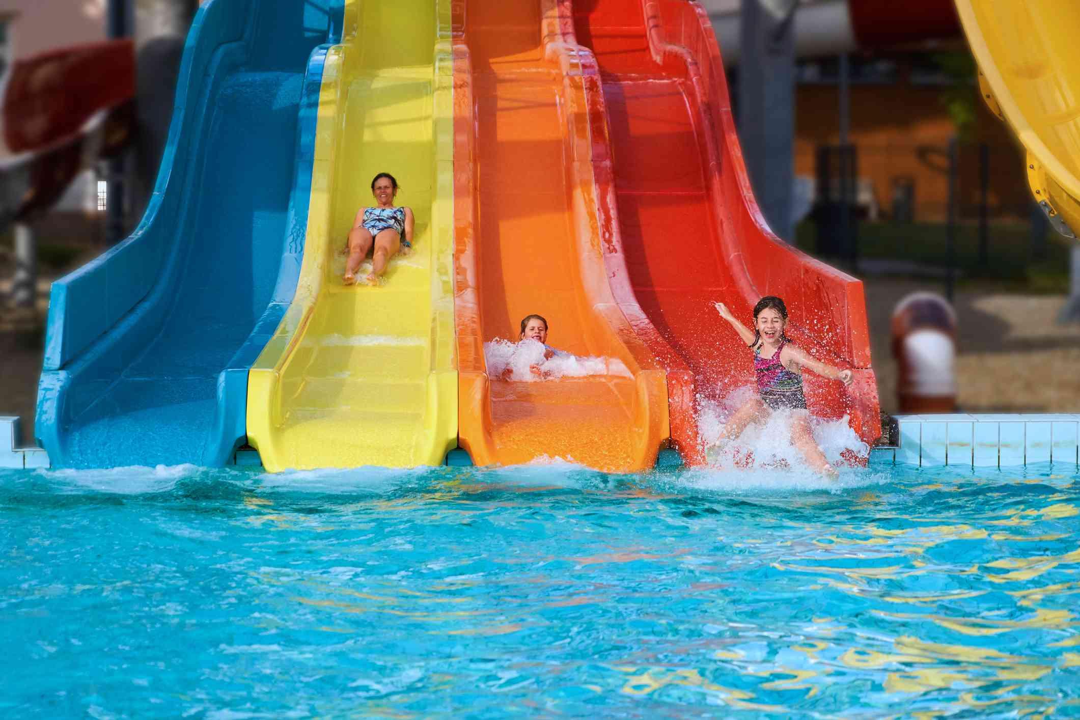 Three girls having fun sliding in a waterpark