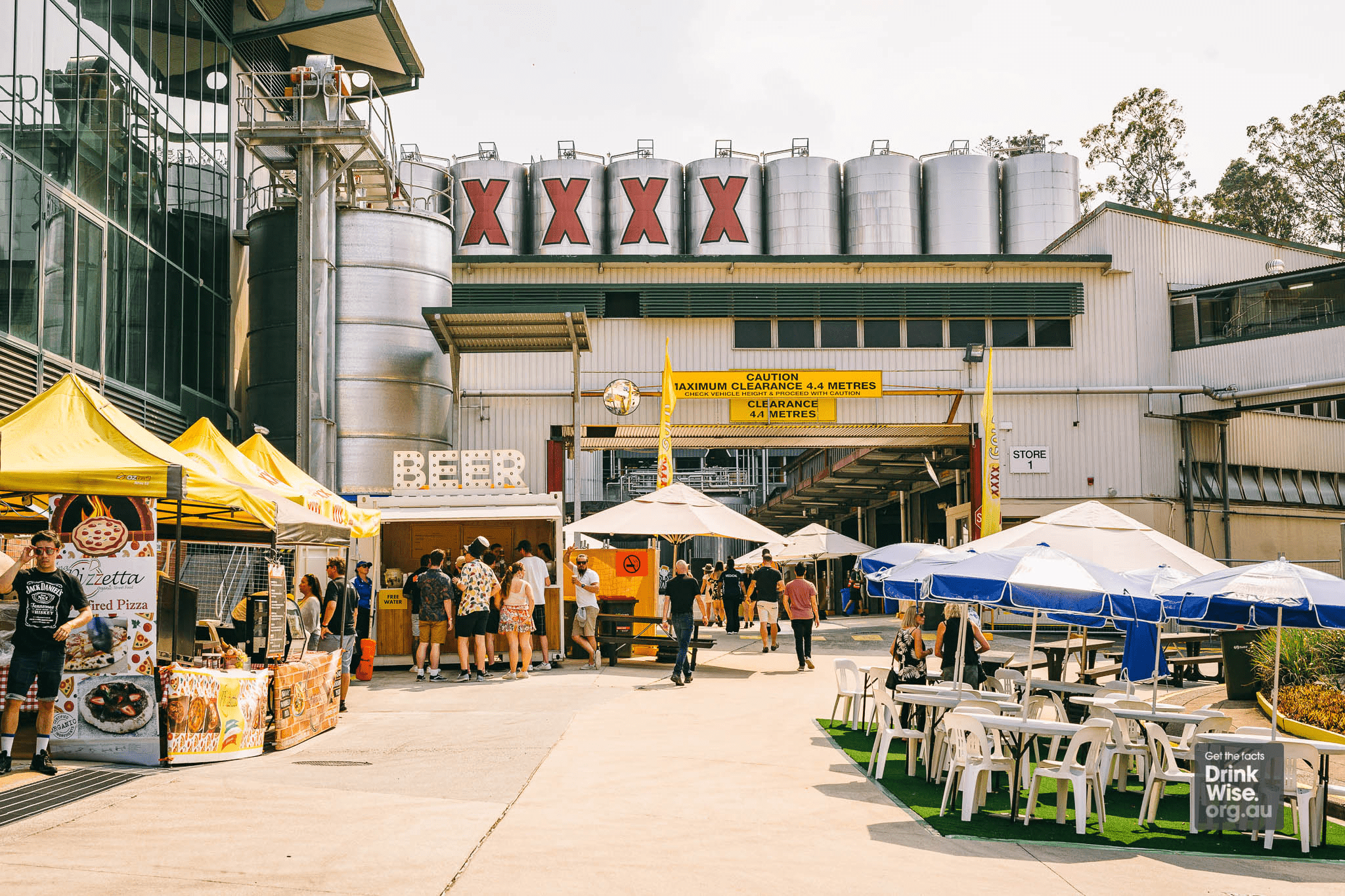 Exterior view of brewery with bar, seating and food stalls
