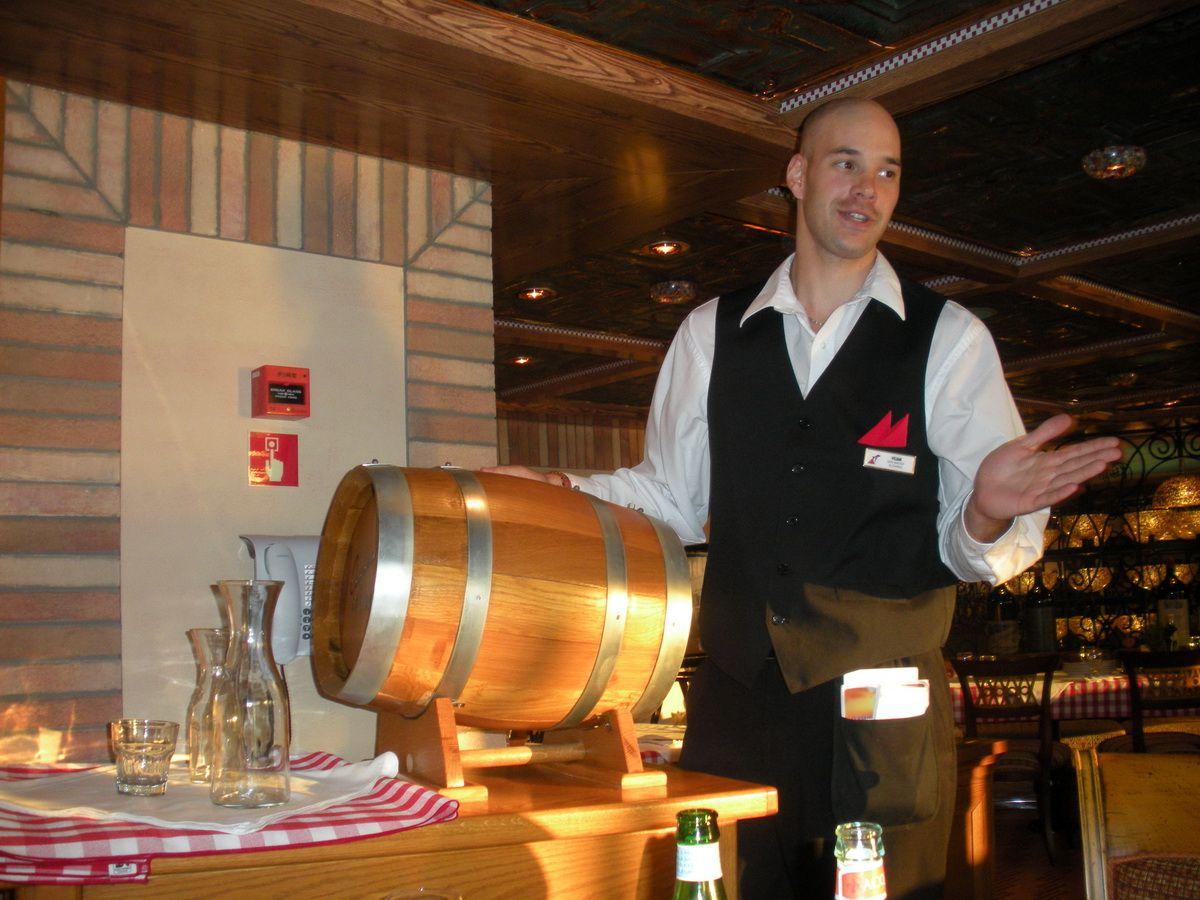 A keg of chianti adds to the fun at Cucina del Capitano on the Carnival Magic cruise ship.