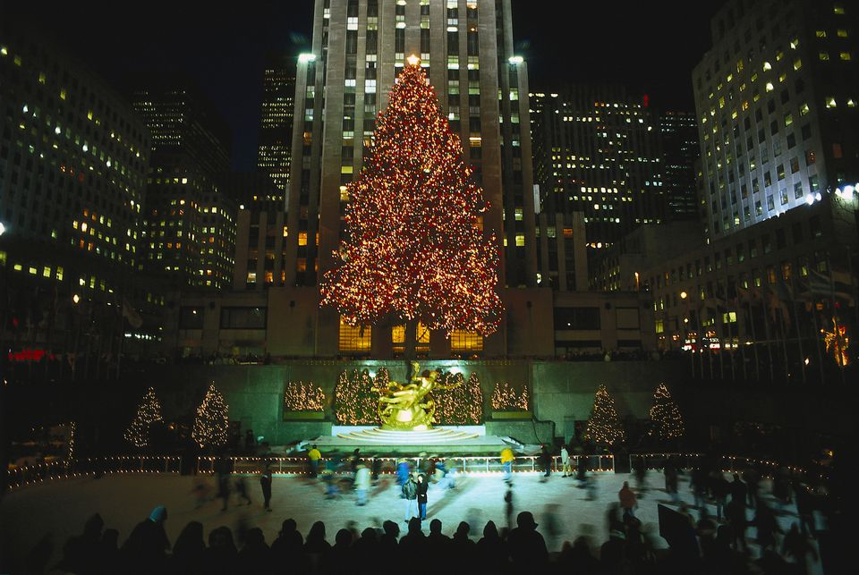 illuminated christmas trees at the ice skating rink at the rockefeller center manhattan new