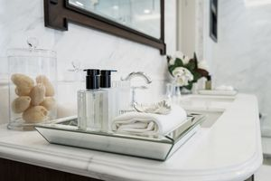 beautiful amenity hotel set on white marble counter in bathroom