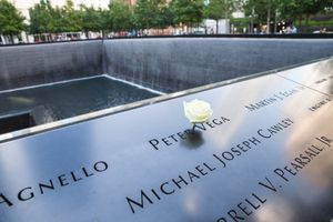 A rose placed in a name on the 9/11 memorial