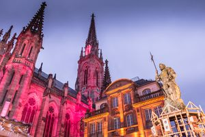 Mulhouse, France: view of the cathedral illuminated and decorated for the Christmas market on a winter day