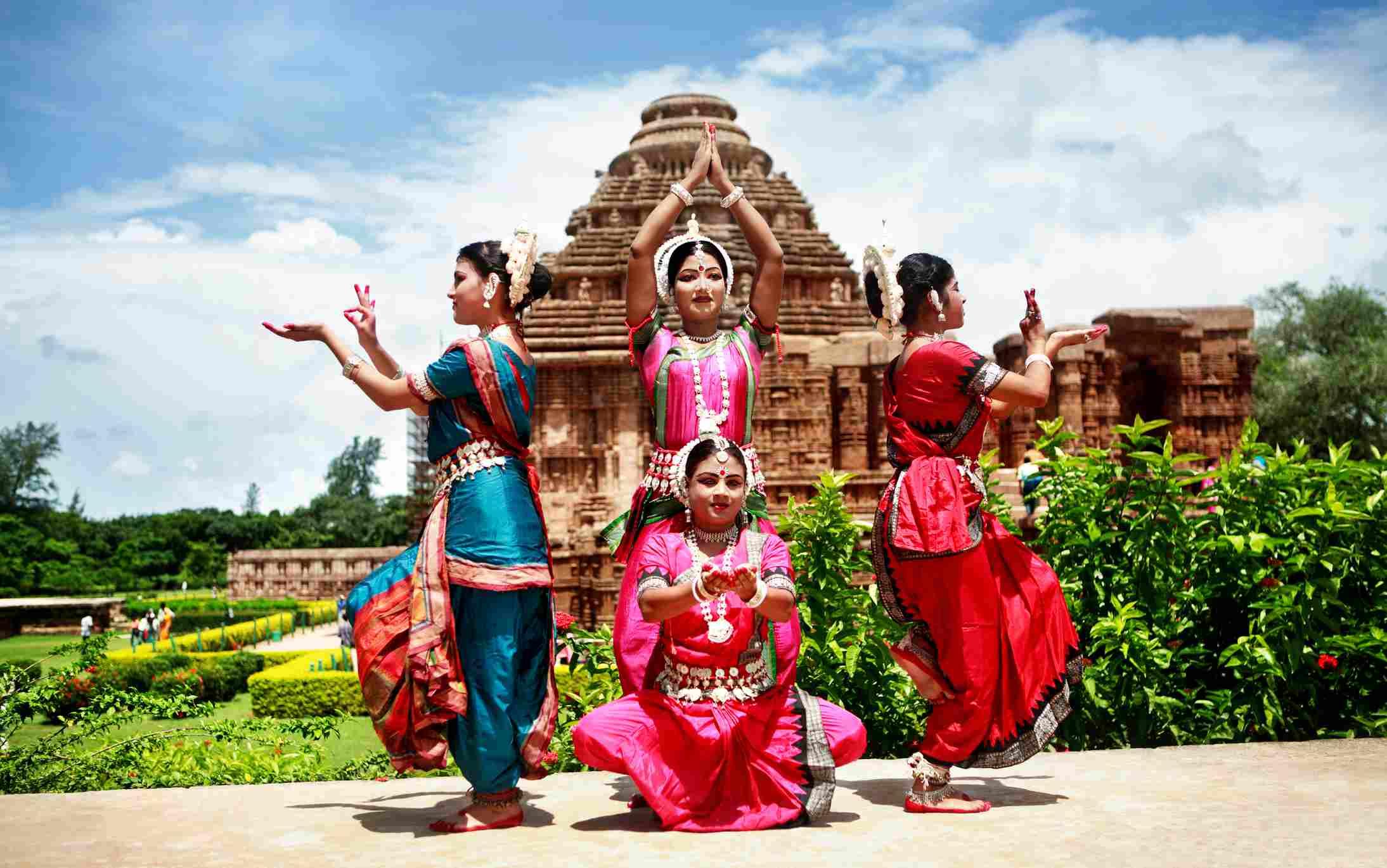 Odissi dancers striking a pose at Konark temple.