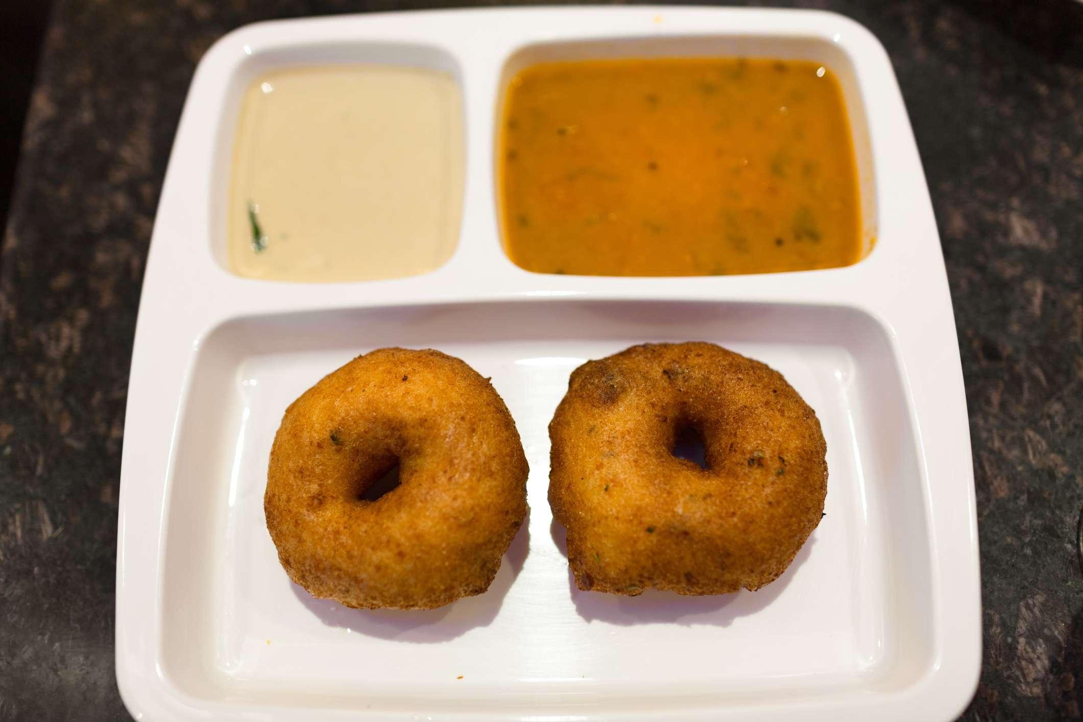 crispy south indian vada served with chutney and sambar