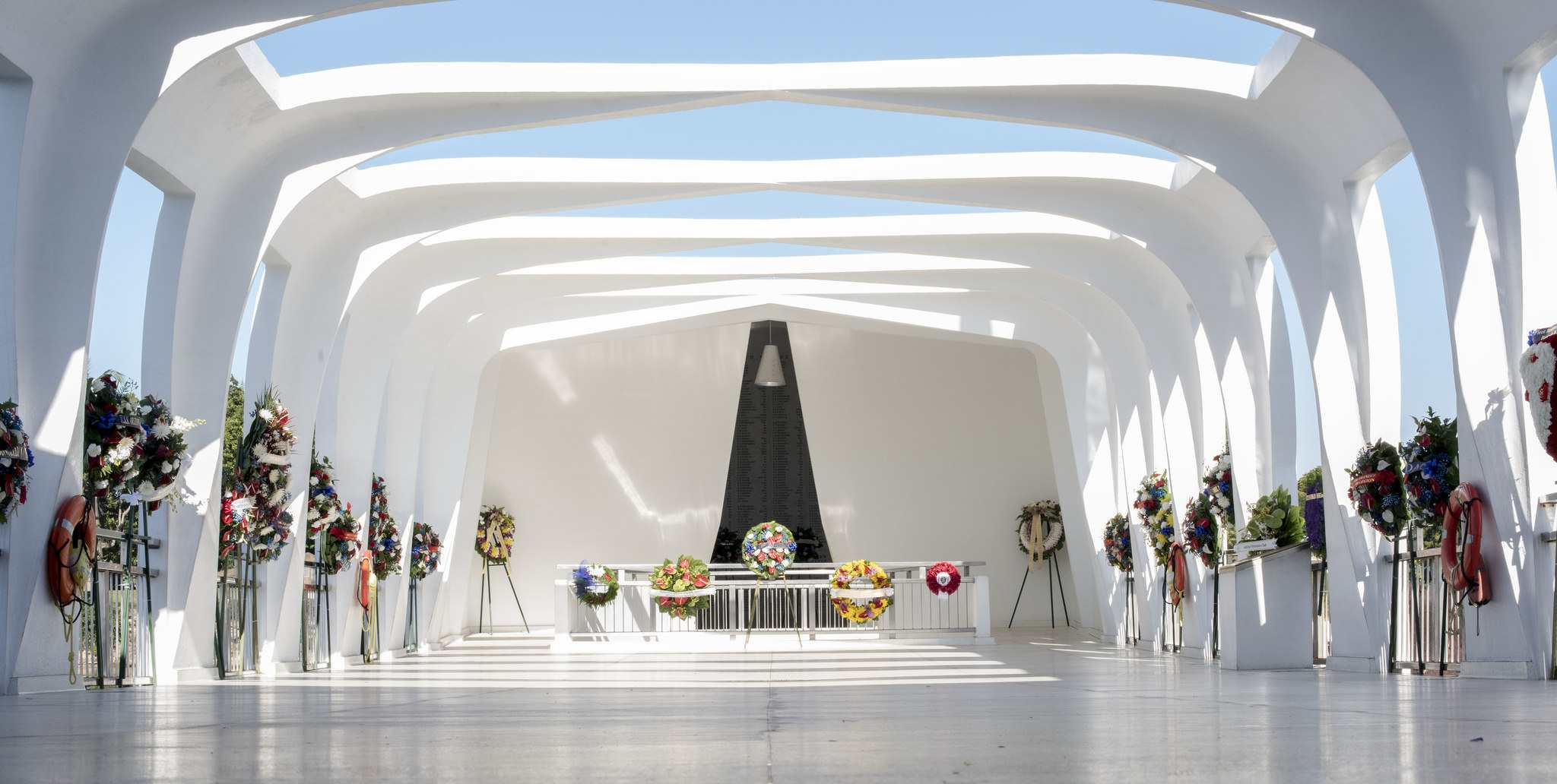 Honorary wreaths adorn the USS Arizona Memorial prior to a floral tribute during the 76th Commemoration Event of the attacks on Pearl Harbor