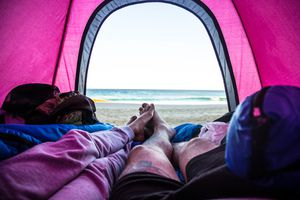 people in a tent on the beach