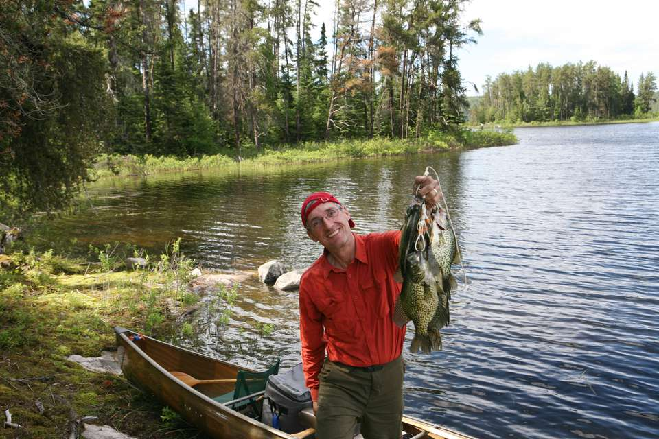 Fisherman with Stringer of Huge Crappies