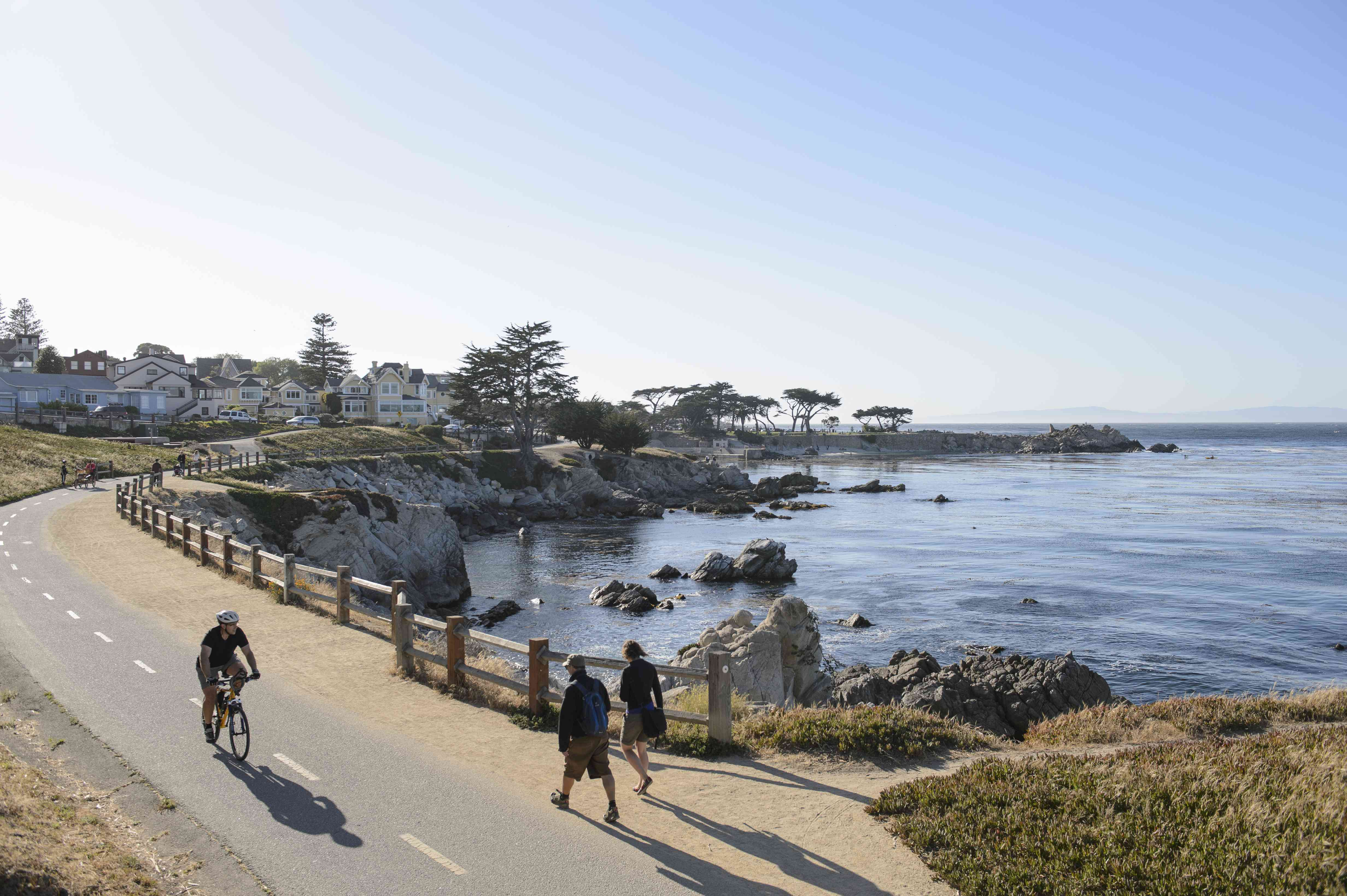 Monterey Bay Coastal Trail with a biker and a couple walking