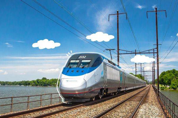 An Amtrak train speeding down the tracks with illustrated lines and clouds