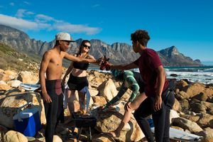 A group of friends barbecuing on the beach in South Africa
